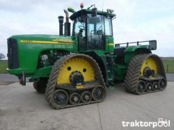 John Deere Quad Track http://www.unusuallocomotion.com/pages/more-documentation/articulated-tracked-vehicles-heavy.html