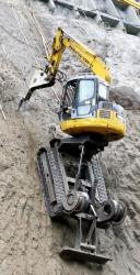 Komatsu excavator on steep slope