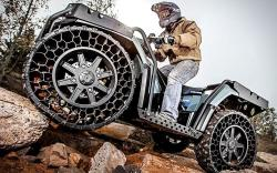Polaris sportsman with airless tires