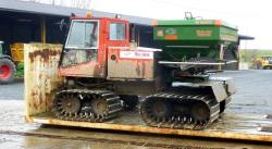 Tracked tractor for spreading