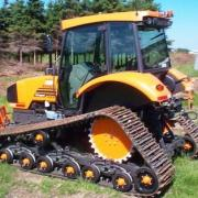 Track kit Go-Storm on Renault Tractor for peat or snow.