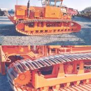 Tracked vehicle for installation of drains