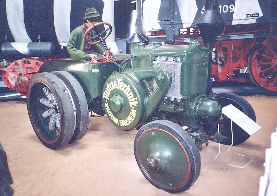 Tractor with spring wheels